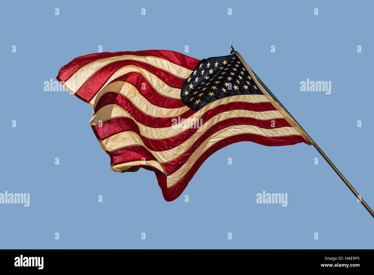 American flag going in all different directions. A representation of the turmoil and dissent in the American people. - Stock Image