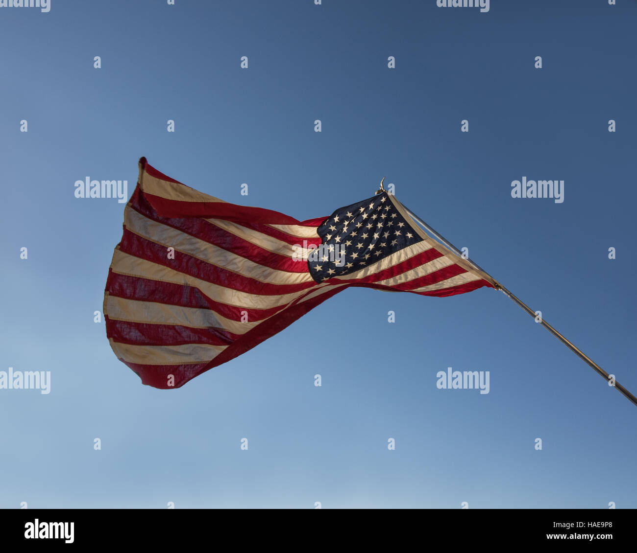 American flag ruffled, in shadow and light. Not fully unfurled. Representing a nation in turmoil. - Stock Image