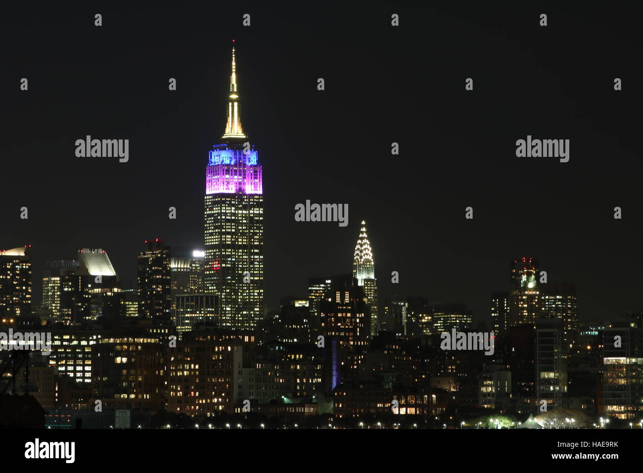 Empire State building with Chrysler building at night, New York - Stock Image