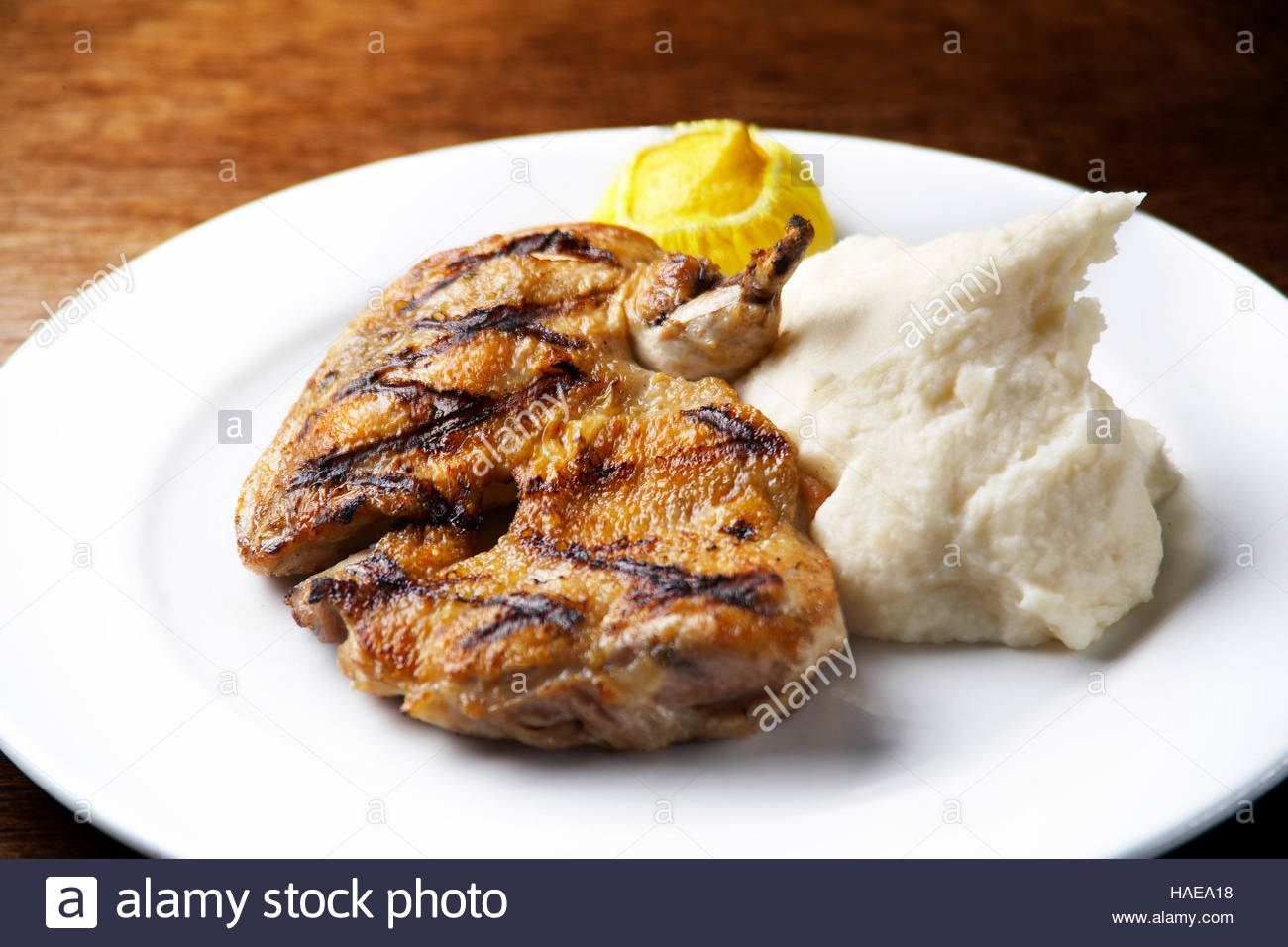 Grilled chicken with mash potatoes - Stock Image