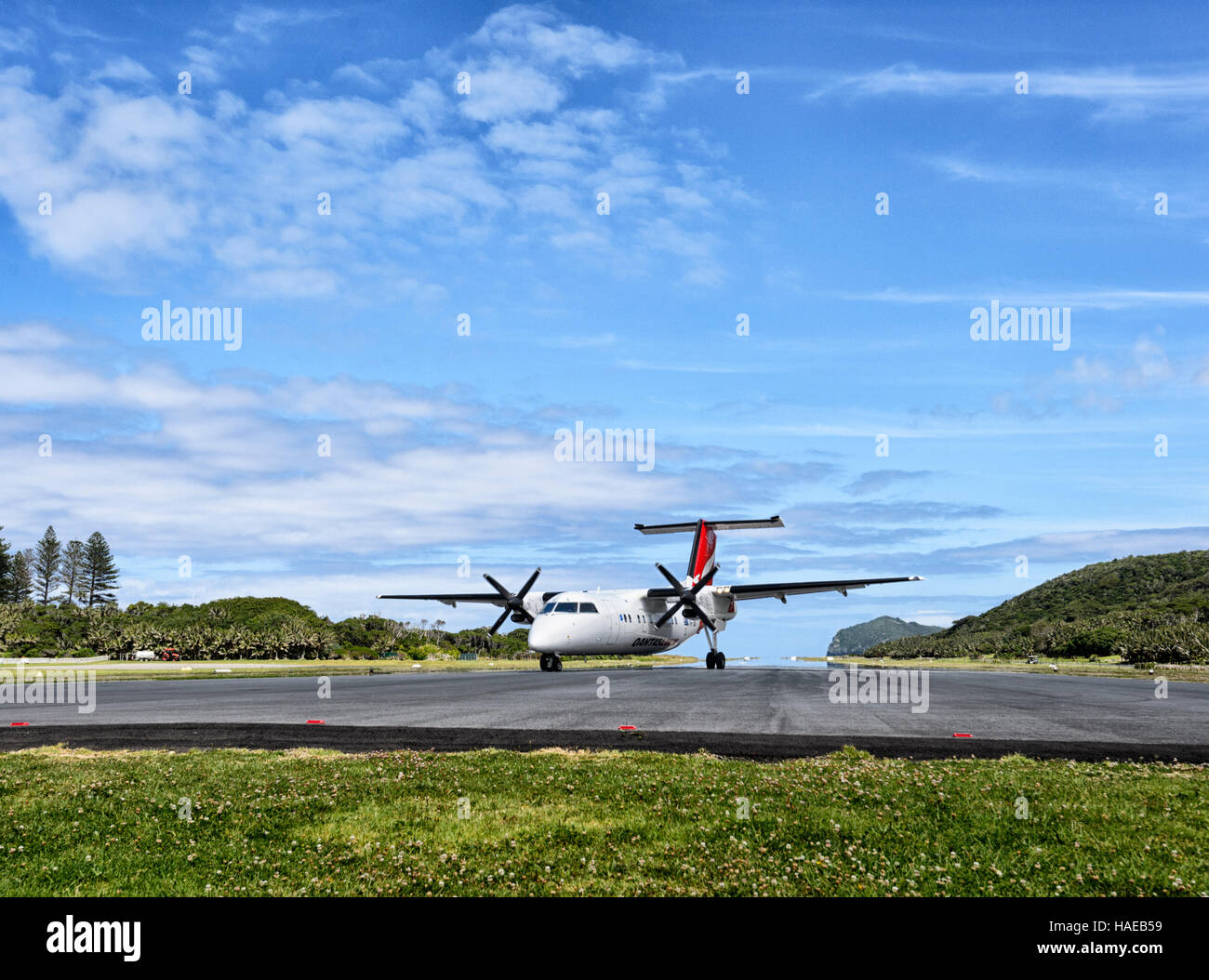QantasLink de Havilland DHC-8 200 Series DASH 8 Aircraft taxiing on Lord Howe Island runway, New South Wales, NSW, - Stock Image