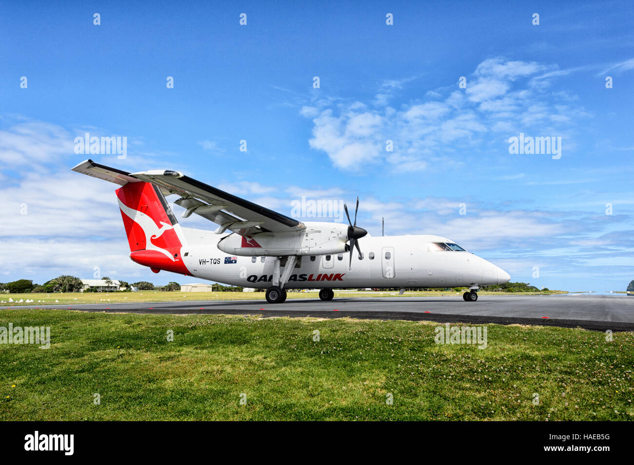 QantasLink de Havilland DHC-8 200 Series DASH 8 Aircraft taxiing on Lord Howe Island runway, New South Wales, Australia - Stock Image