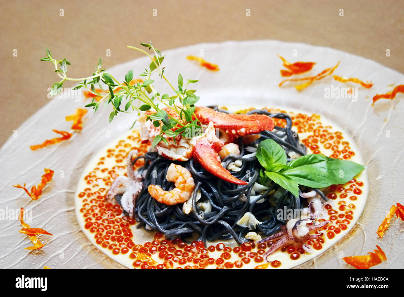 Black pasta with lobster cream sauce and caviar - Stock Image