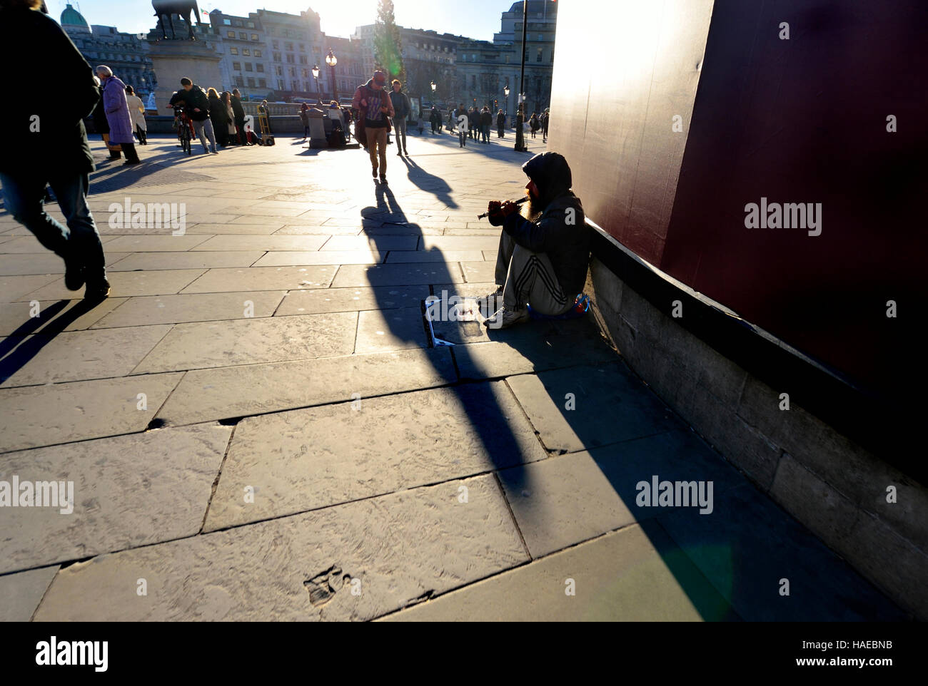 London, England, UK. Homeless (possibly) man playing the recorder in Trafalgar Square - Stock Image