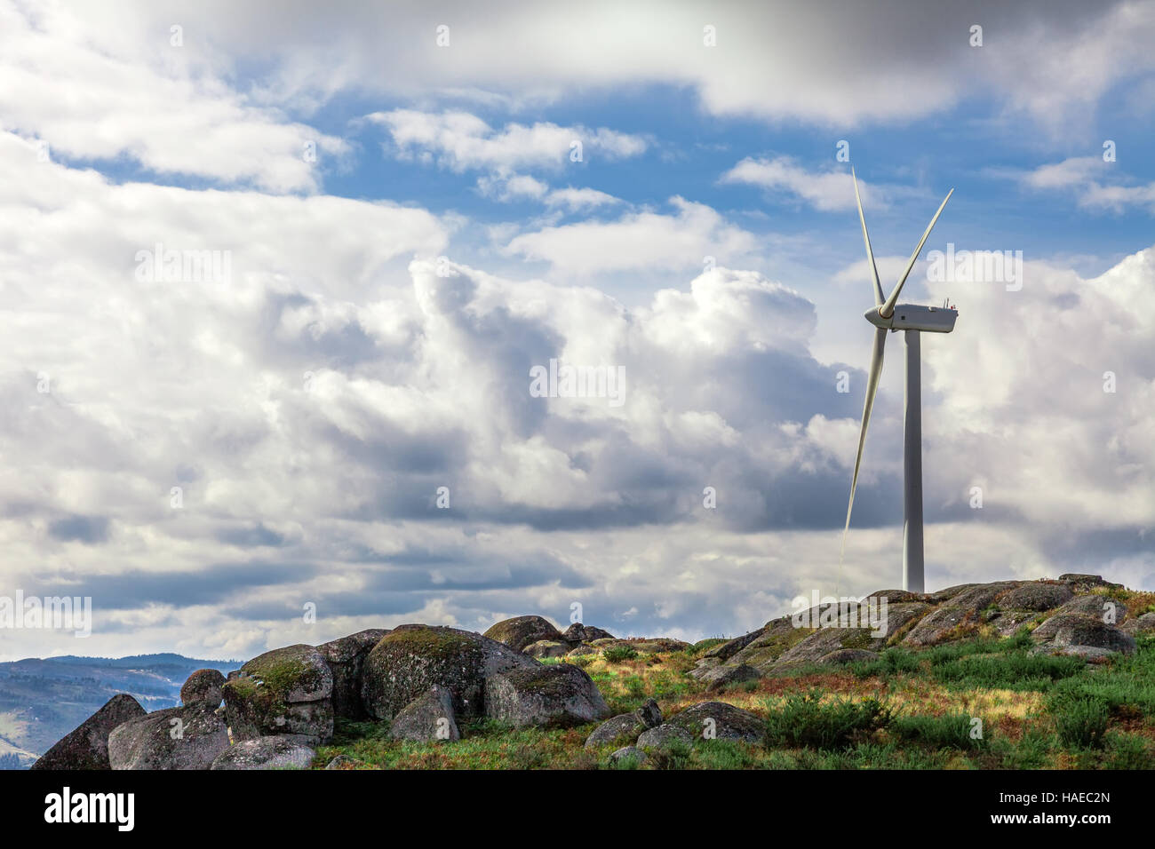 Wind turbine generator on top a hill for the production of clean and renewable energy near Fafe, Portugal - Stock Image