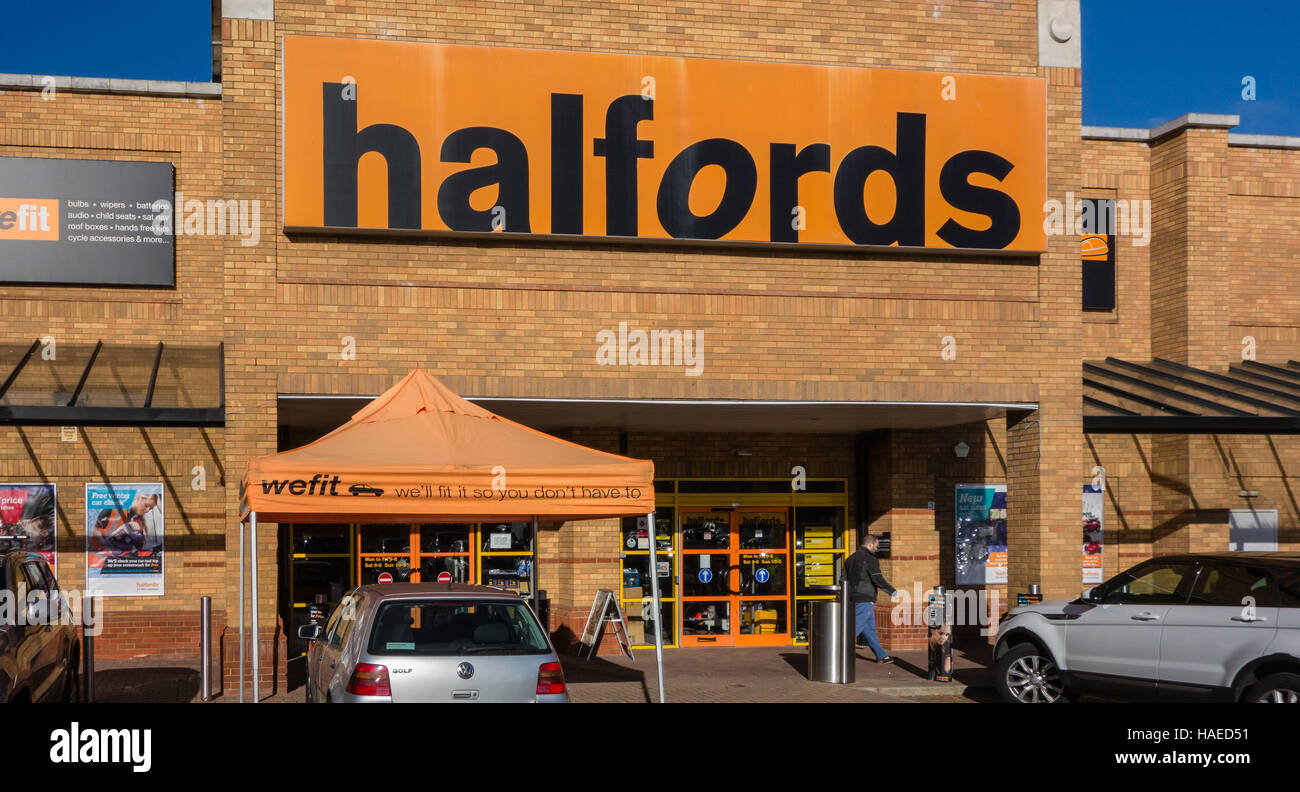 Entrance to halfords retail shop in Woking, Surrey, UK - Stock Image