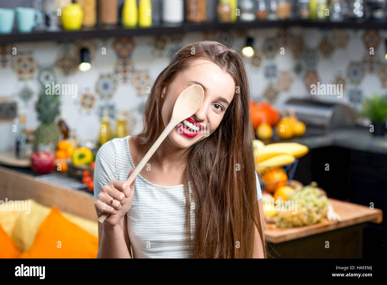 Woman in the kitchen - Stock Image