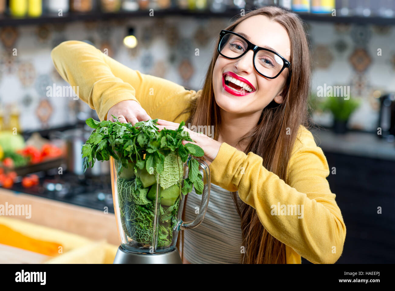 Woman making smoothie - Stock Image