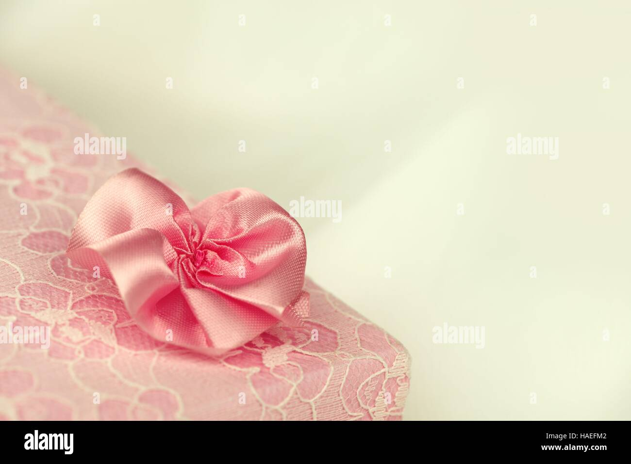 Pink lace gift box with a flower and floral ornament - Stock Image