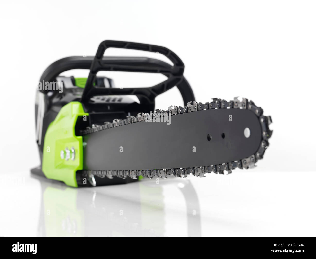 Electric Cordless battery powered chainsaw isolated on white - Stock Image