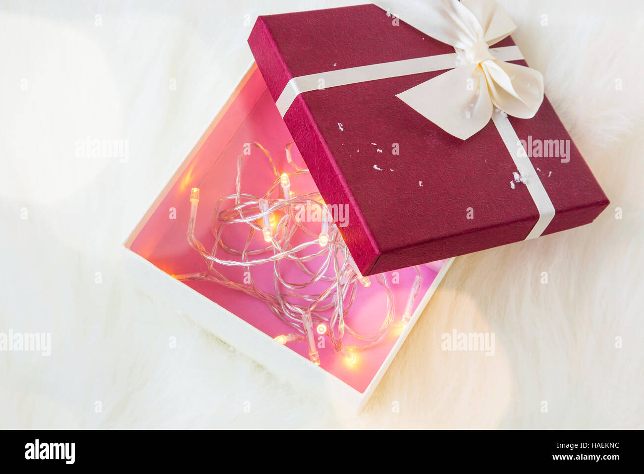 festive christmas gift box decorated with tree lights inside