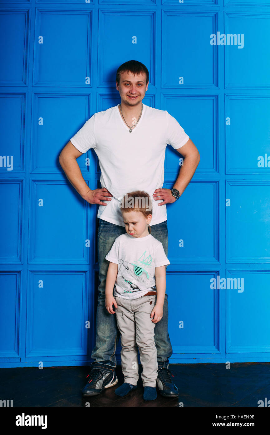 Young father and son playing together portrait. Studio shot. - Stock Image