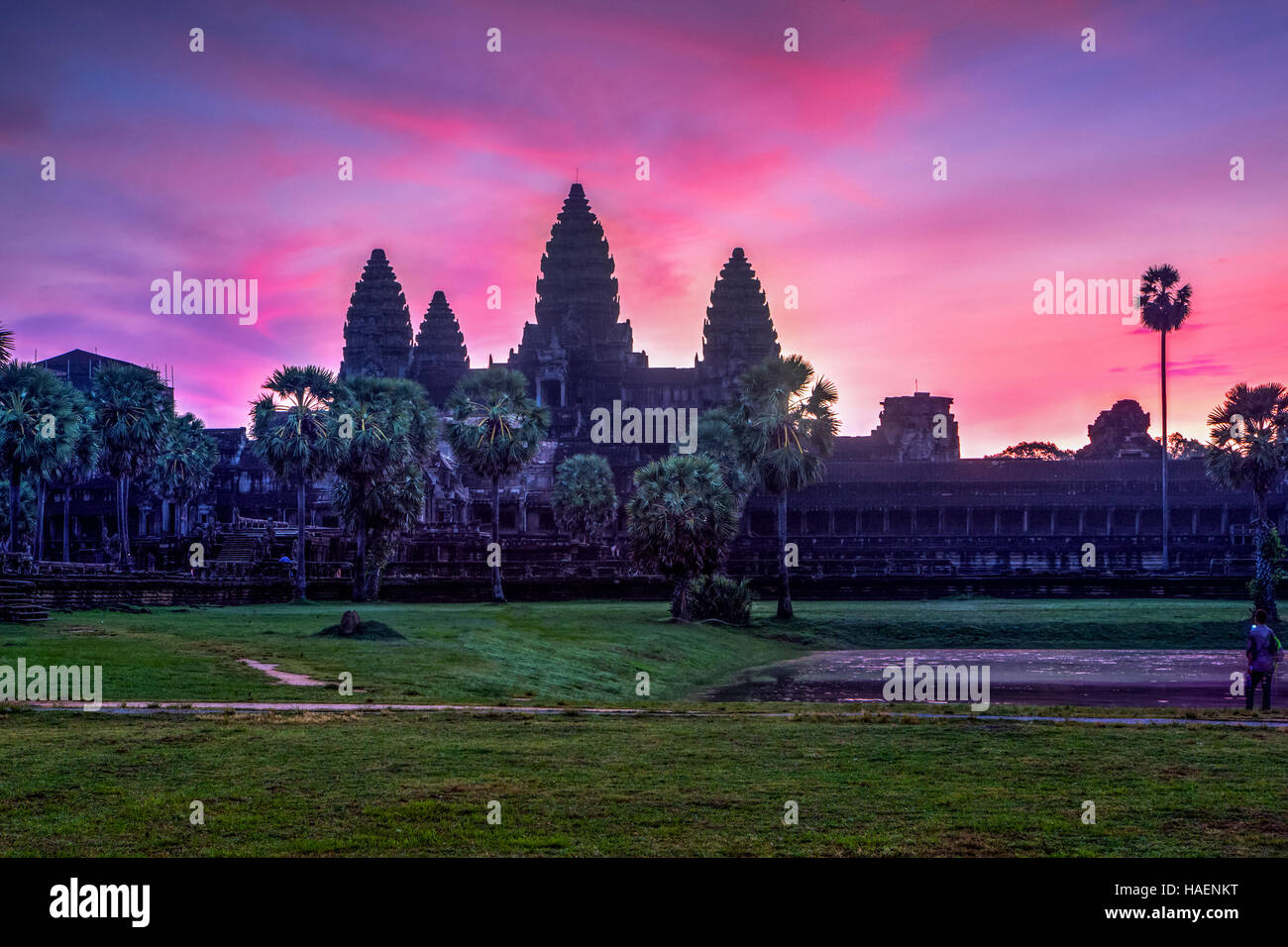 Vibrant, colourful sunrise at Angkor Wat, Kingdom of Cambodia. - Stock Image