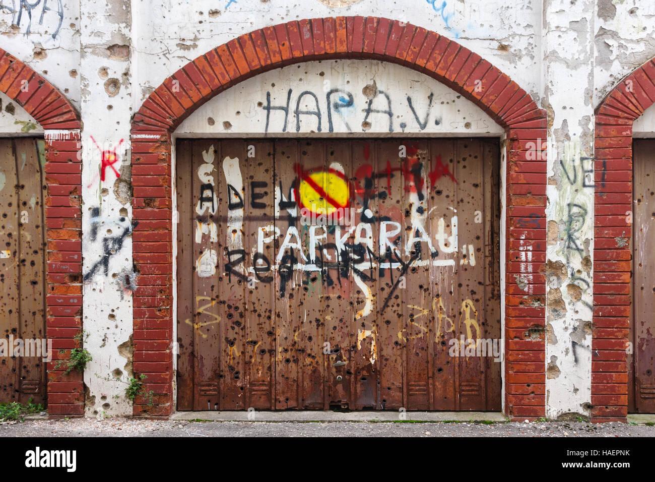 Garage door in Mostar, riddled with bullets, Bosnia-Herzegovina - Stock Image