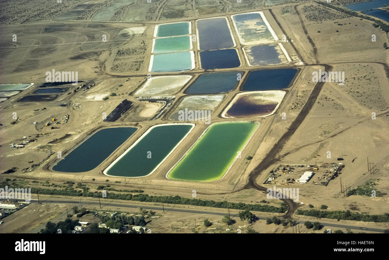 An aerial view of several large man-made settling and evaporating ponds in the Mojave Desert used in the 1980s for - Stock Image