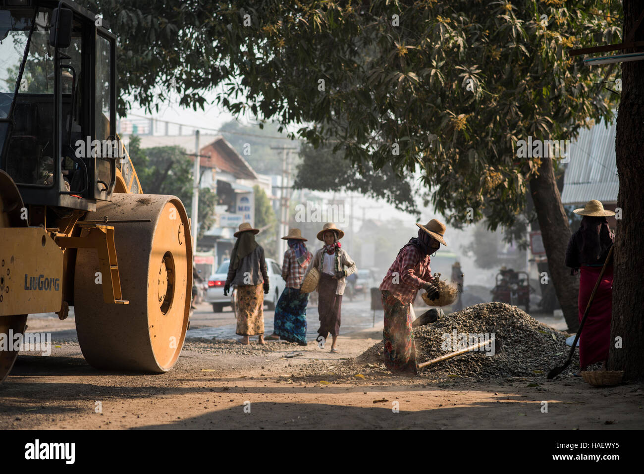 A group of female road workers laying tarmac in Bagan, Myanmar. - Stock Image