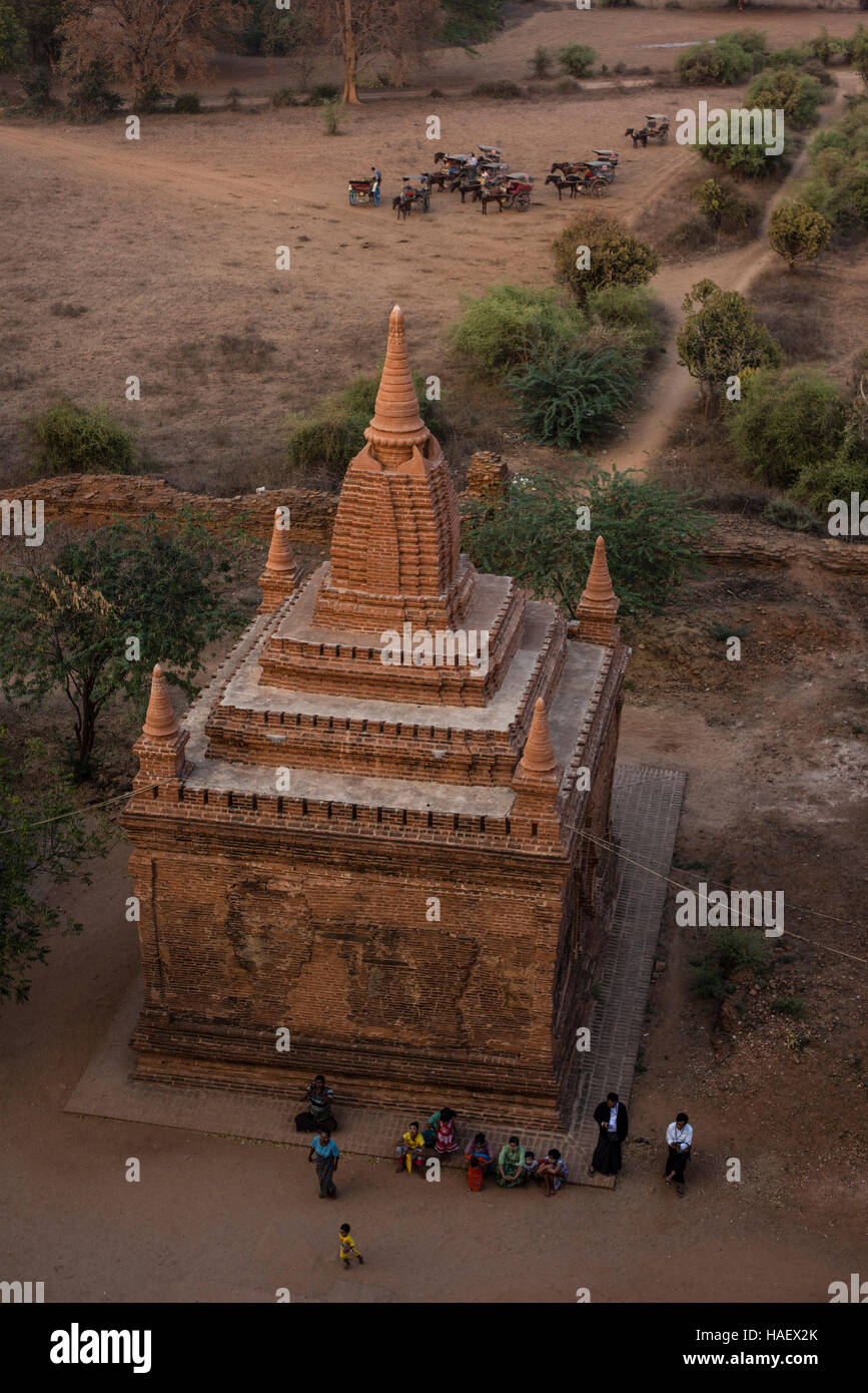 View of temples of Bagan Historical site and horse carts, Myanmar. - Stock Image