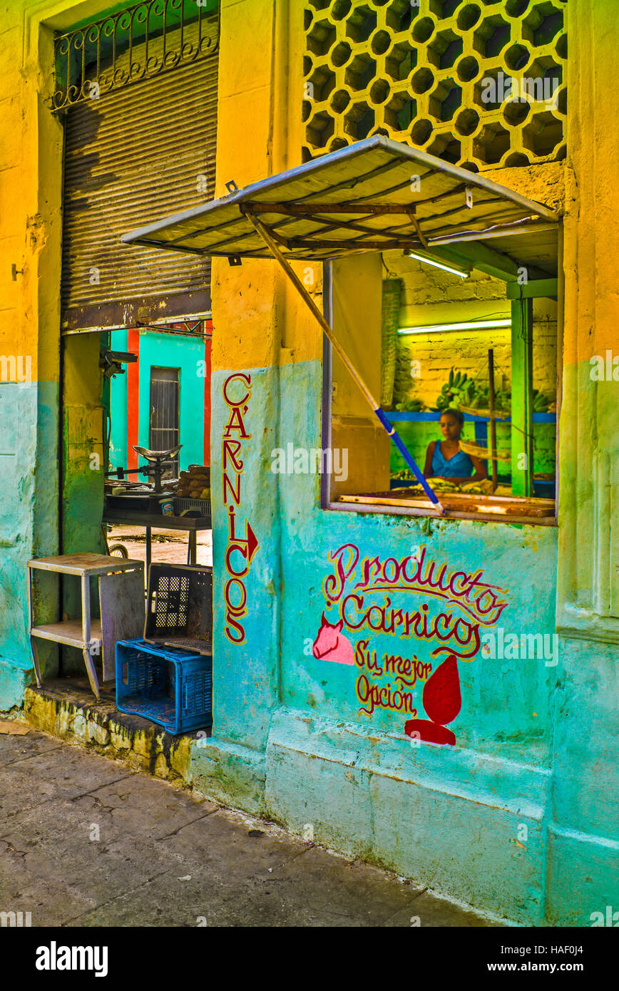 Havana Cuba Productos Carnicos state owned butcher colorful yellow and green painted shop front - Stock Image