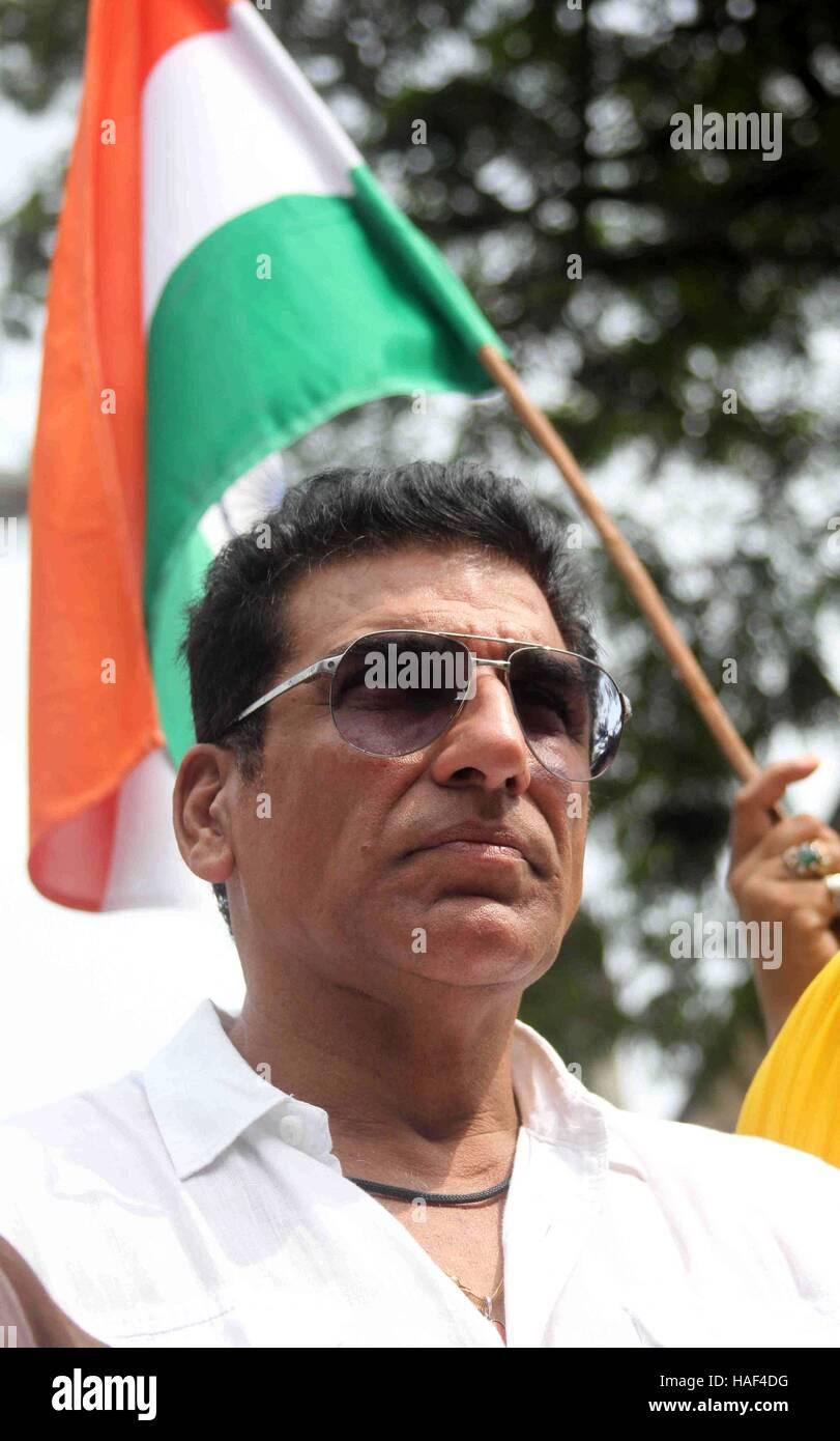 Bollywood actor Mukesh Rishi pay tributes to slain Indian soldiers at Azad Maidan Army Memorial, in Mumbai - Stock Image