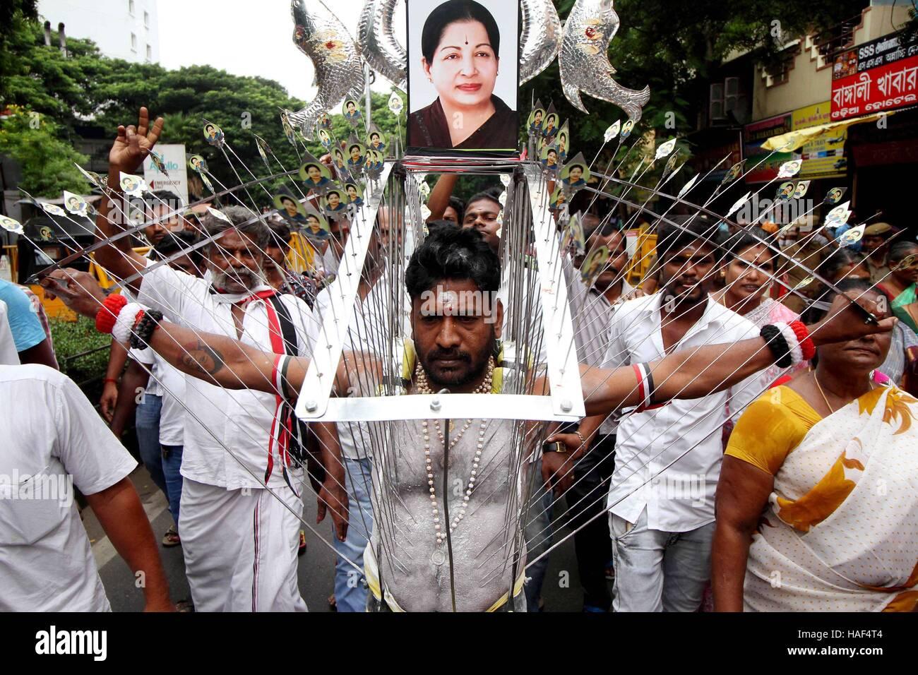 AIADMK party worker body pierced metal hooks offer prayer Tamil Nadu Chief Minister J Jayalalithaa speedy recovery - Stock Image