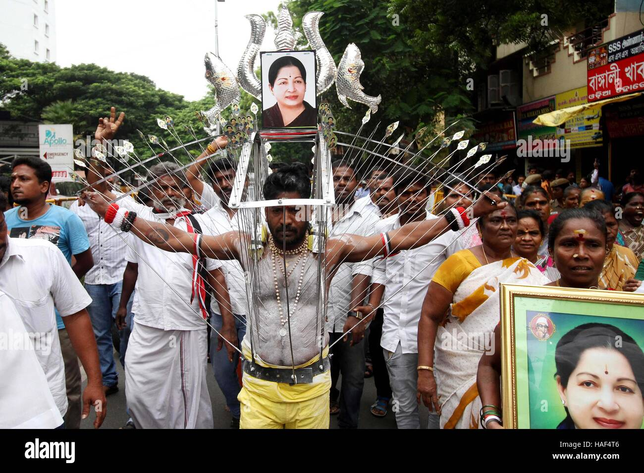 AIADMK party worker body pierced with metal hooks offer prayer Tamil Nadu Chief Minister J Jayalalithaa speedy recovery - Stock Image