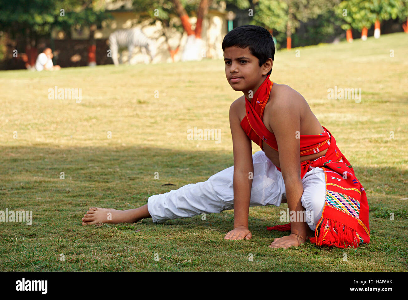 Boy doing whirling movement of right feet called Chatravali, covering the floor like an umbrella, Pune, Maharashtra. - Stock Image