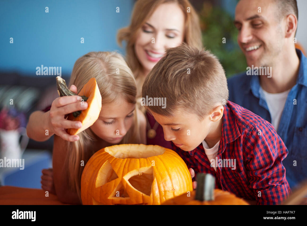 Drilled pumpking and curious children - Stock Image