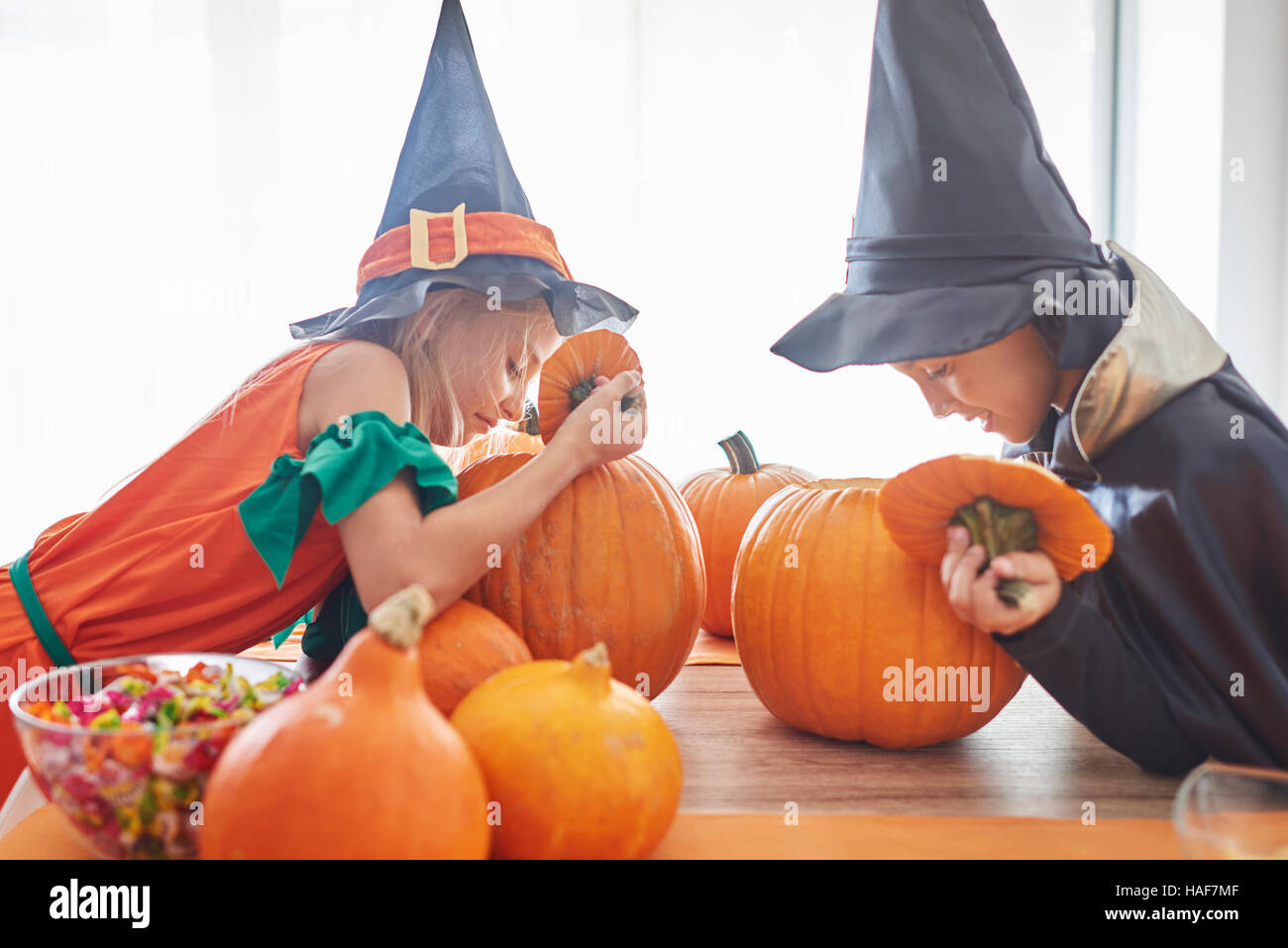 Curious children looking into the pumpkin - Stock Image