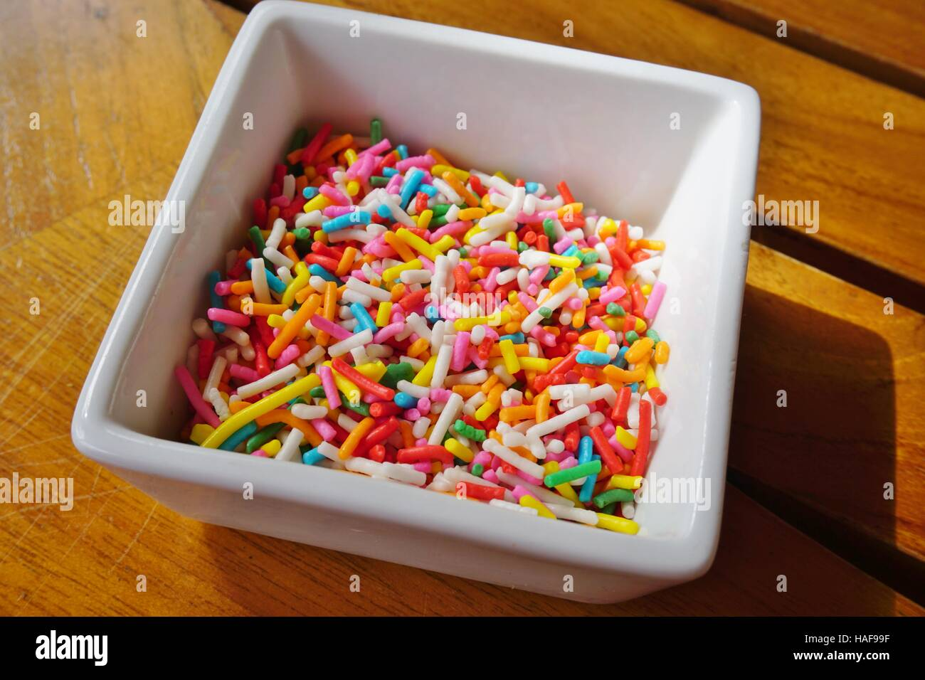 Bowl of colorful edible confetti sprinkles Stock Photo