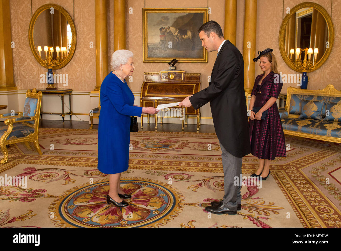 Queen Elizabeth II meets Ambassador of Sweden Torbjorn Sohlstrom and his wife Helena during a private audience at - Stock Image