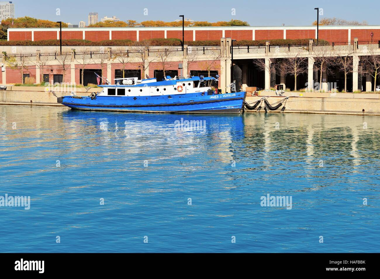A lone ship is tied up in a Lake Michigan inlet channel across from Chicago's Navy Pier. Chicago, Illinois, - Stock Image