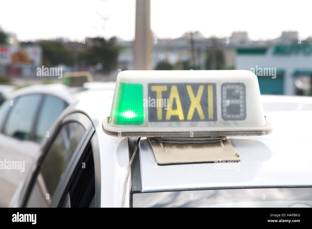 Taxi cab with green light on to show availability Stock