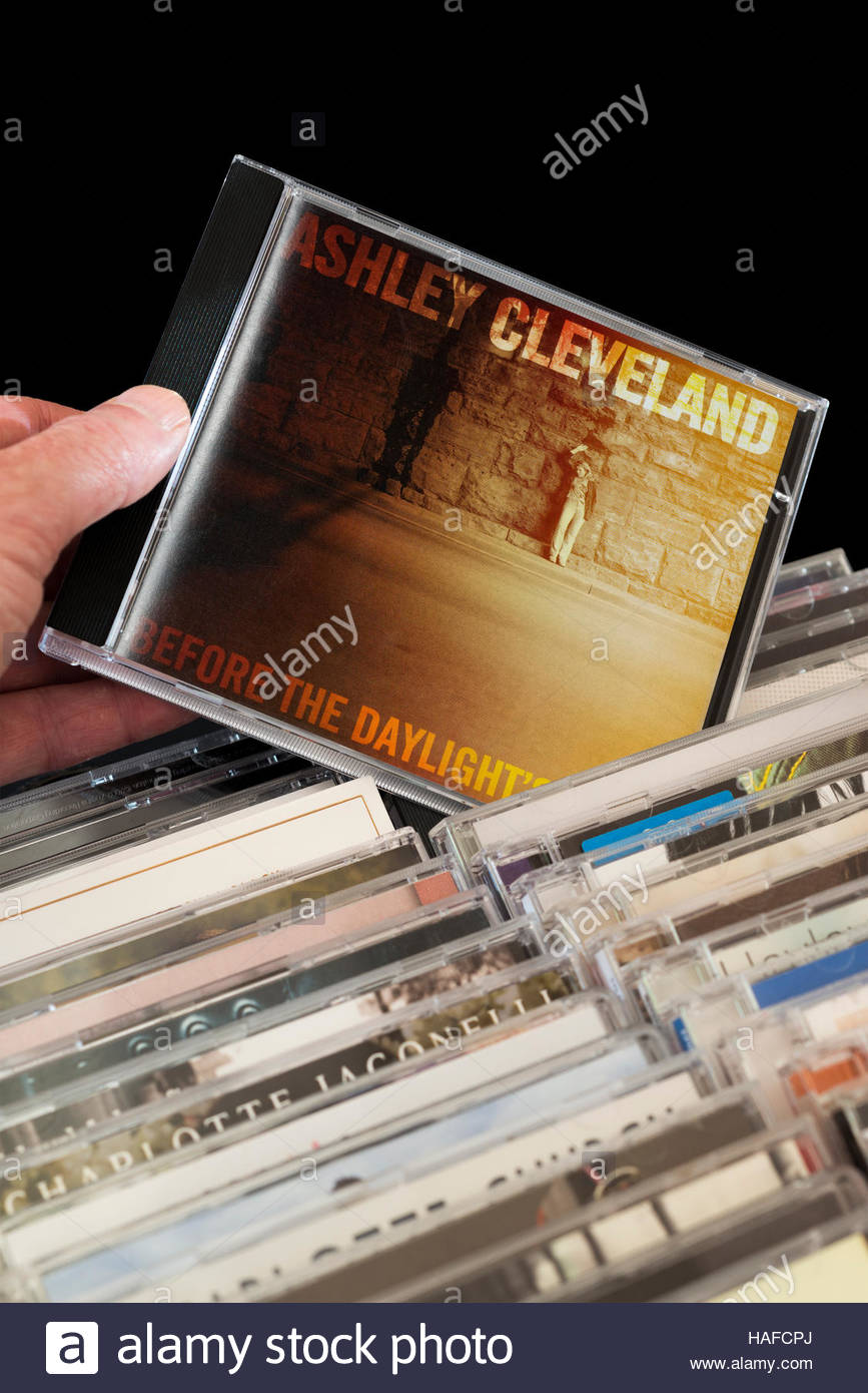 Before the Daylight's Shot, 2006 Ashley Cleveland CD being chosen from among rows of other CD's - Stock Image