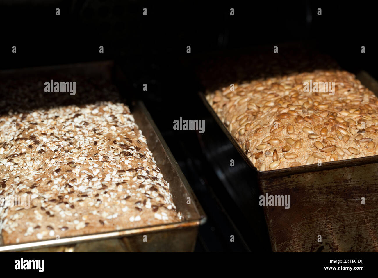 two hot bread in bread stove as background - Stock Image
