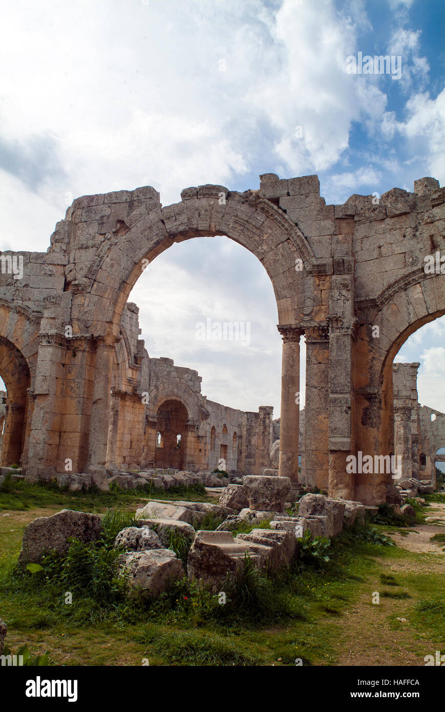 Tourists at the ruins at the Church of Saint Simeon Stylites,  5th century AD Byzantine ruins, before the Syrian - Stock Image