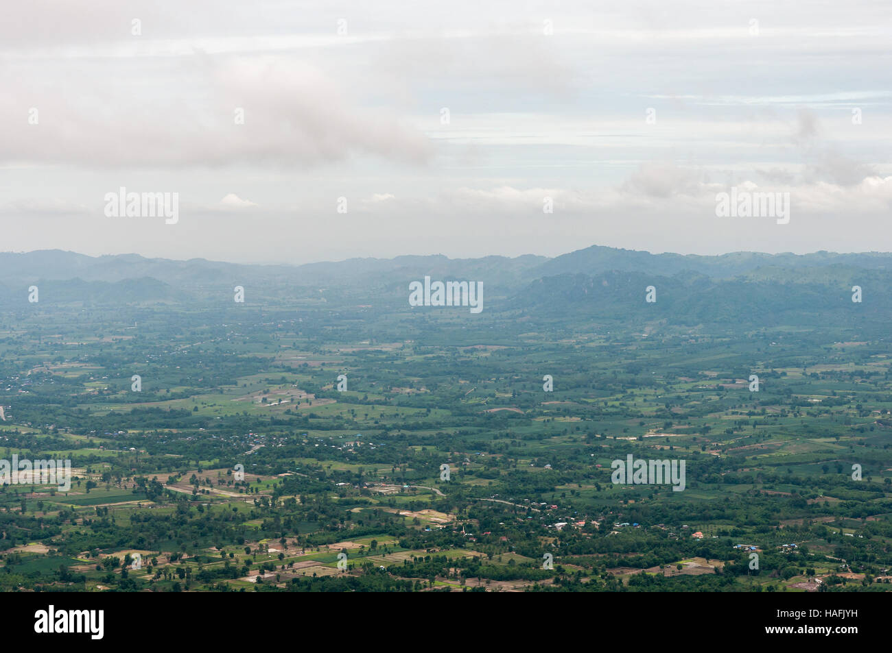 Bird eye view scene from the high mountain with light mist in the early morning. - Stock Image