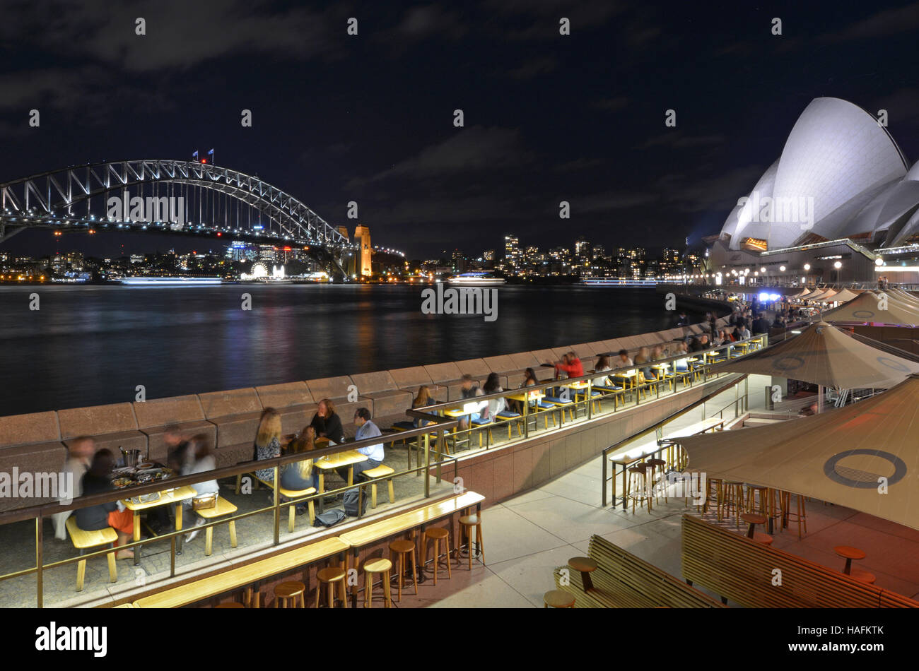 Sydney Harbour Bridge and the Opera House skyline at night as view from Sydney cove in Sydney New South Wales, Australia. - Stock Image