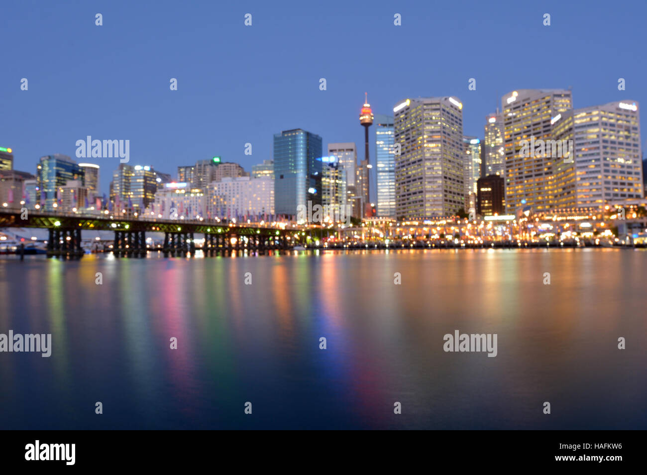 Blurry background of Darling Harbour at dusk in Sydney Australia. - Stock Image