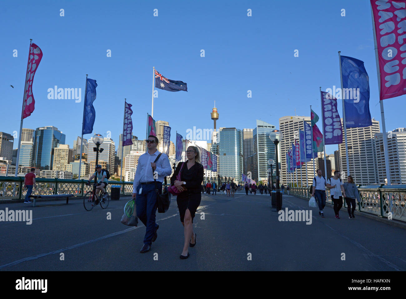 SYDNEY - OCT 20 2016:Visitors crossing the Pyrmont Bridge at sunset in Darling Harbour, a recreational and pedestrian - Stock Image