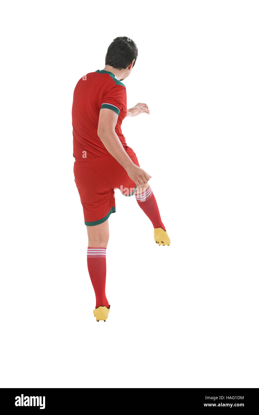 28411d8aa Back view of asian football player kick ball isolated over white background