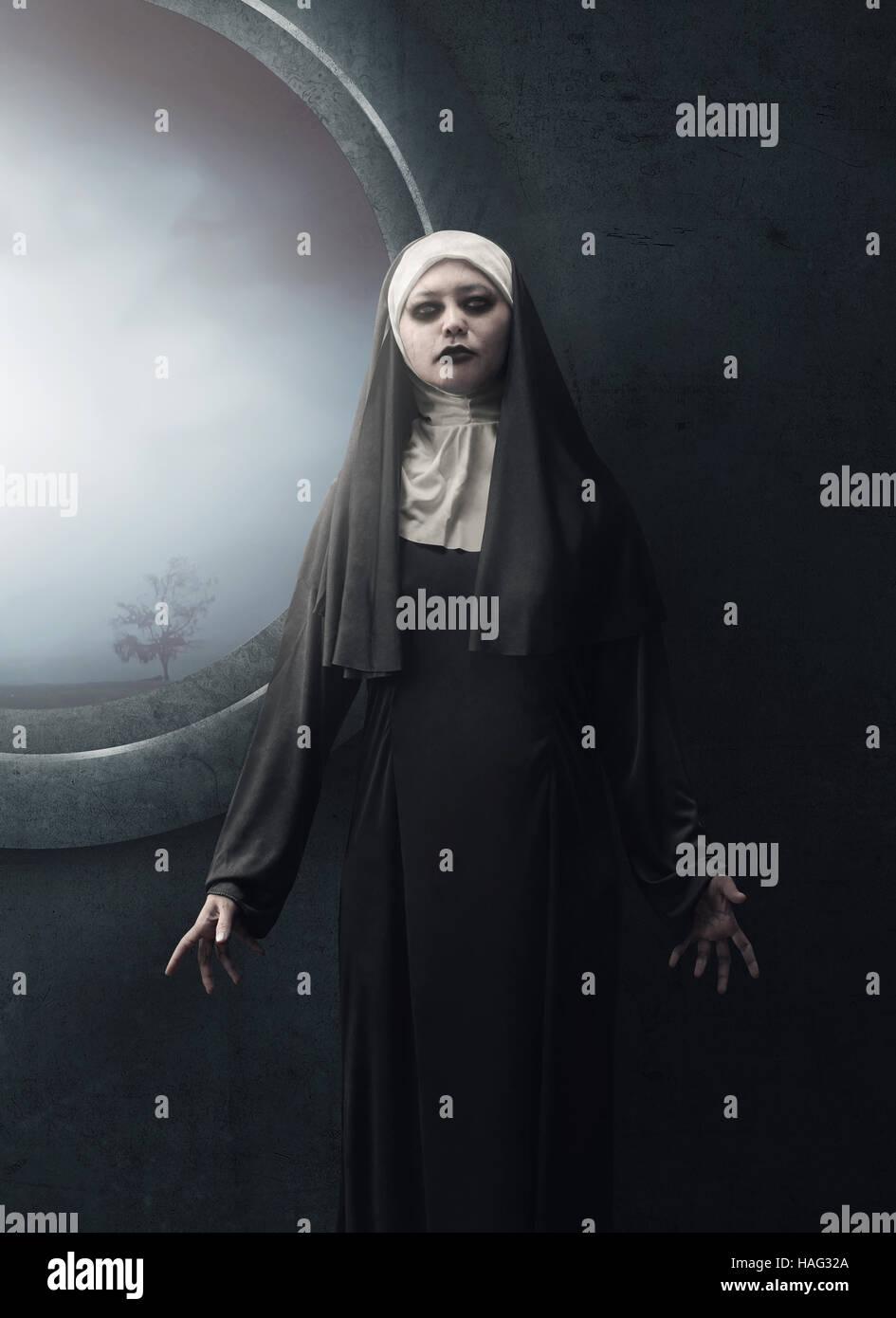 creepy asian woman nun standing beside the dark window stock photo
