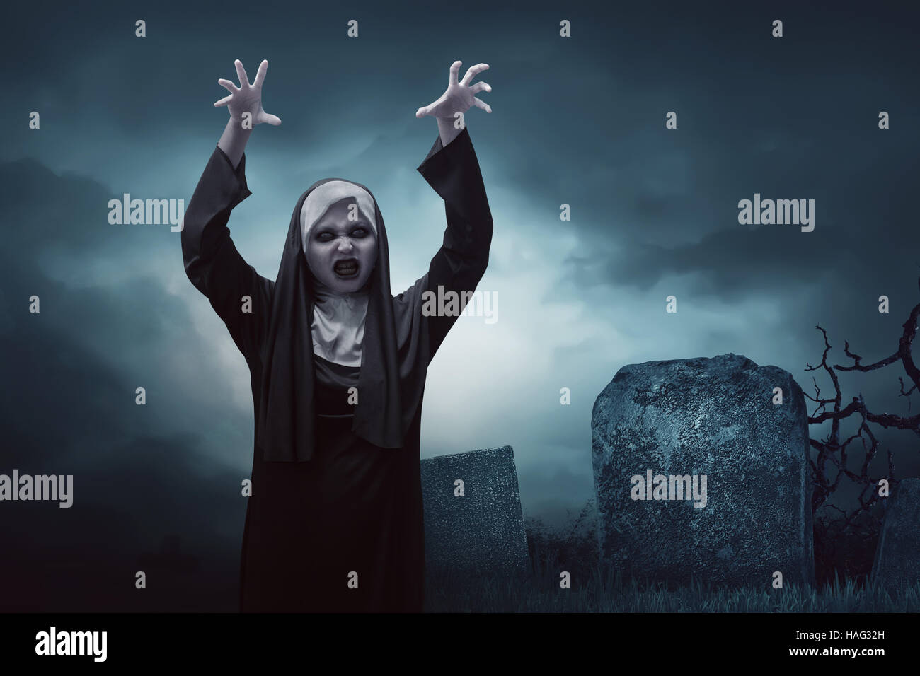 scary young asian nun woman in graveyard at night stock photo