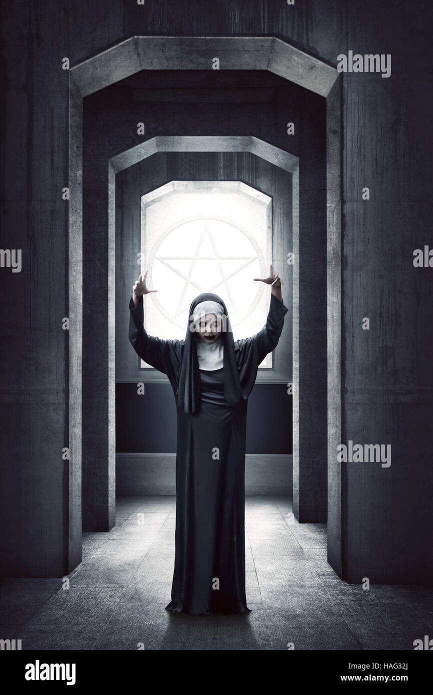 young evil asian woman nun standing with white pentagram on the