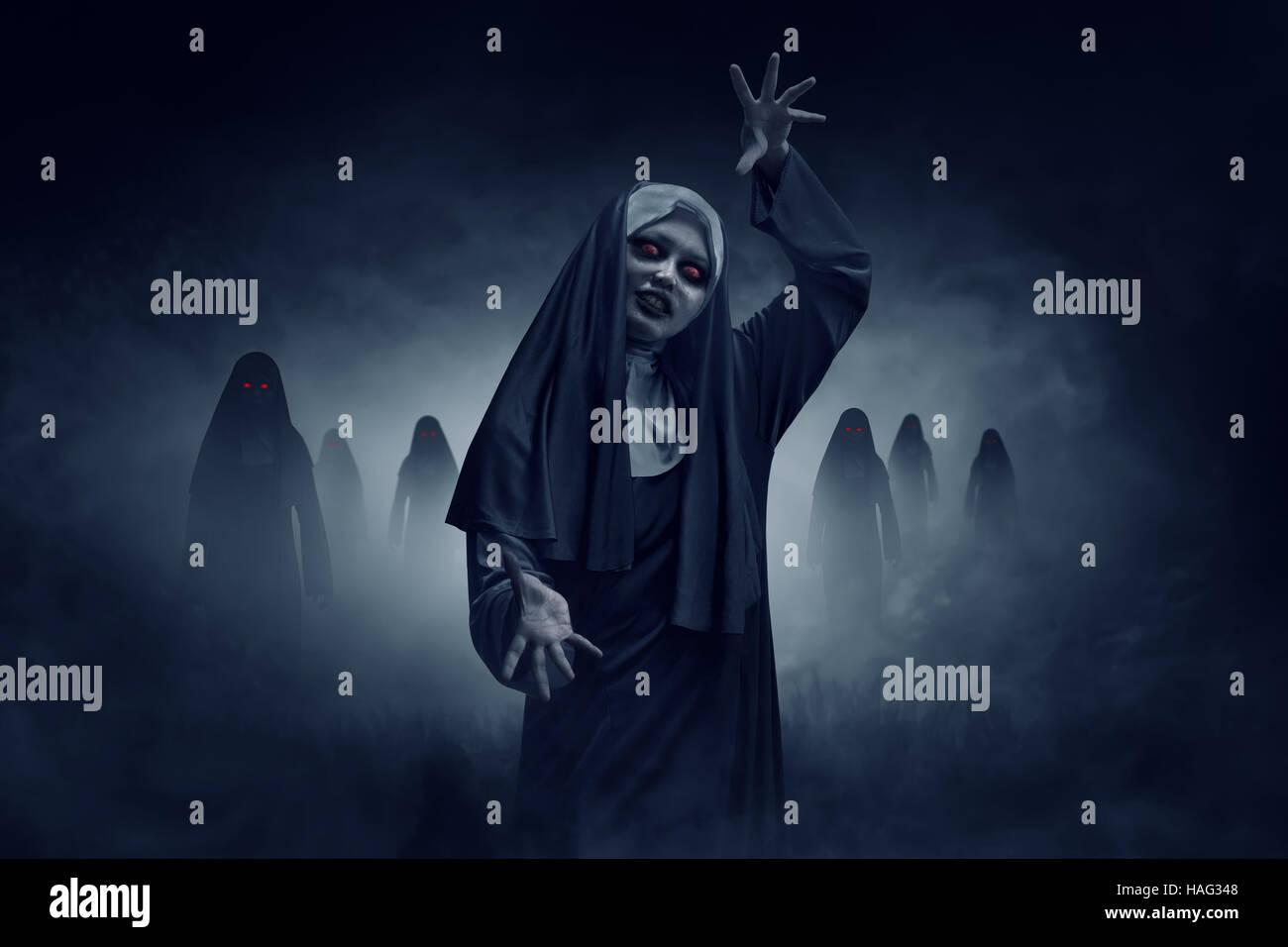young evil asian woman nun scare on the dark room stock photo