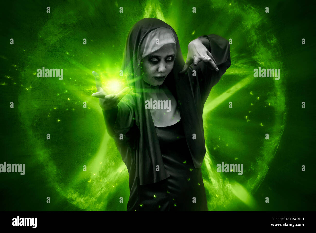 scary asian nun casting spell. halloween concept image stock photo