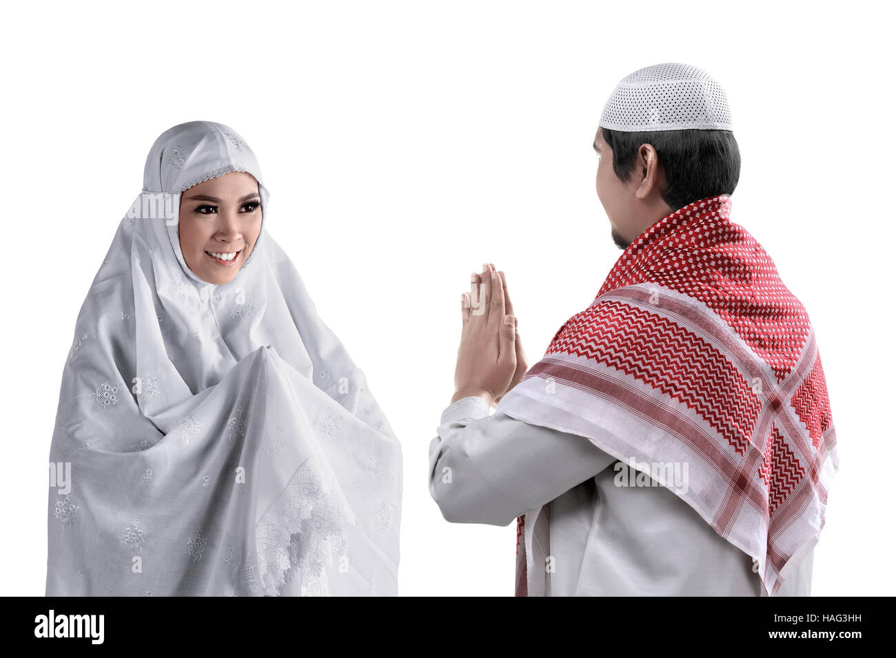 Muslim couple white dress stock photos muslim couple white dress asian muslim man and woman greet each other with muslim tradition isolated white background m4hsunfo