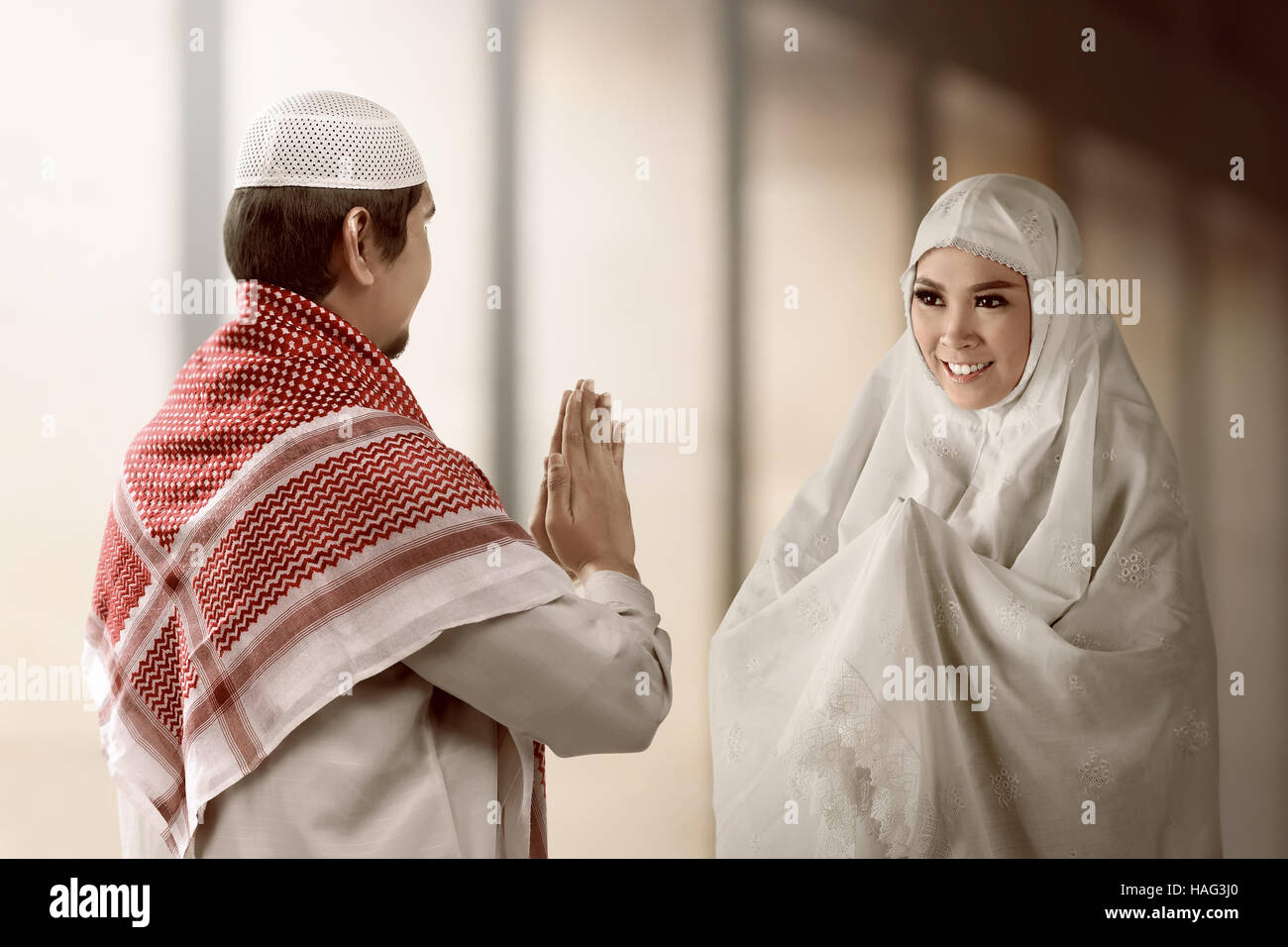 Indonesian couple muslim stock photos indonesian couple muslim asian muslim man and woman greet each other with muslim tradition with mosque background m4hsunfo