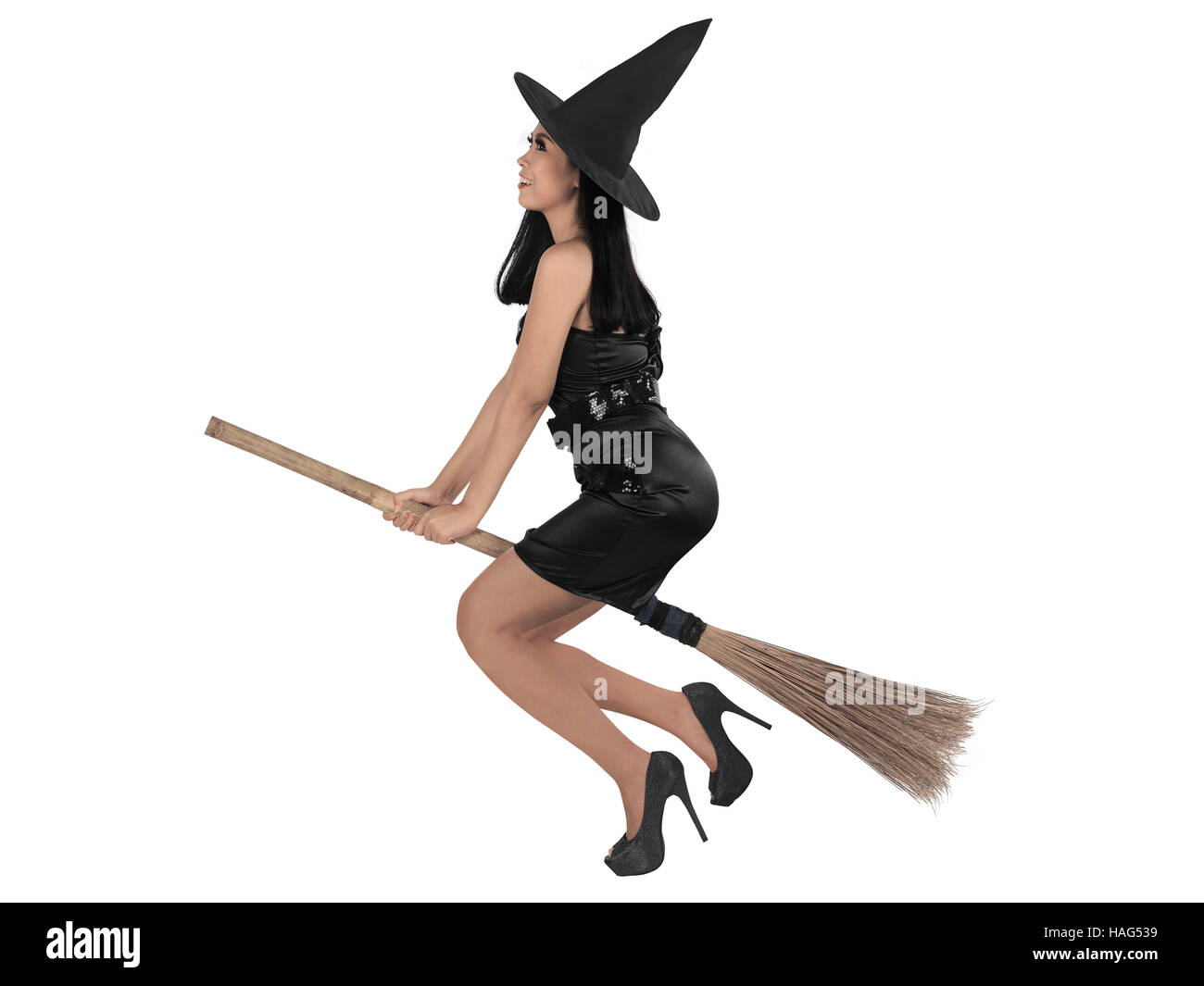 Asian witch woman ride the broom, isolated over white background - Stock Image