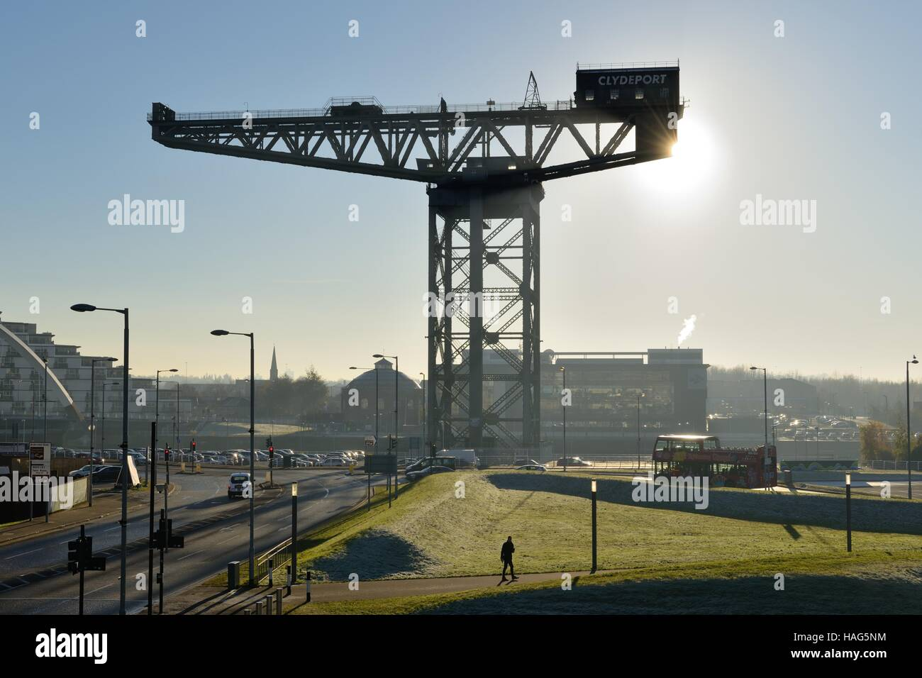 Winter sun emerging from behind the Clydeport Crane at Finnieston, Glasgow, Scotland, UK - Stock Image