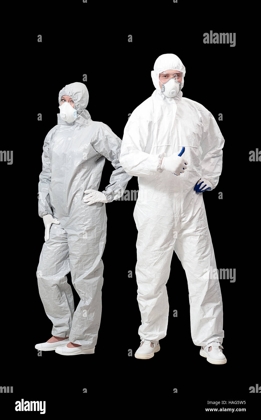 man and woman in overalls bio hazard materials  isolated on black background. - Stock Image